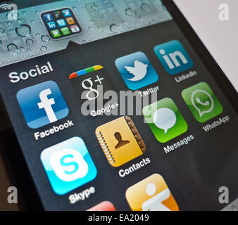 Social media apps on an Apple iPhone smartphone such as Facebook, Twitter, LinkedIn, Skype and WhatsApp  Model Release: - Stock Photo