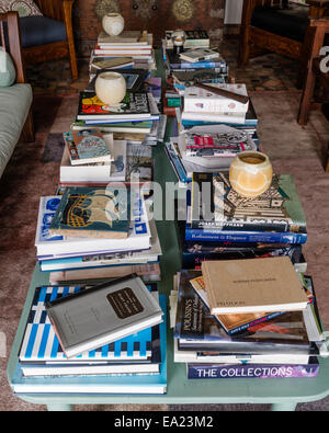 coffee table with piles of books - Stock Photo