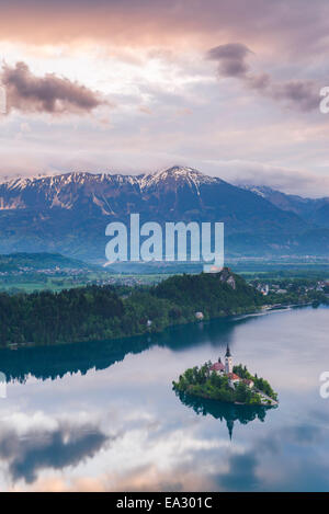 Lake Bled Island and the Julian Alps at sunrise, seen from Osojnica Hill, Bled, Julian Alps, Gorenjska, Slovenia, - Stock Photo