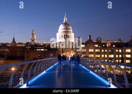 London 19 Aug 2013 : Saint Paul's Cathedral dome illuminated at night from a blue lit Millennium Bridge, London, - Stock Photo