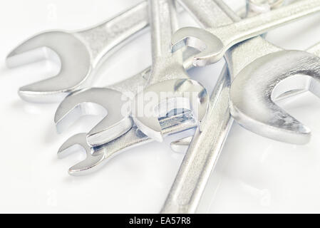 Wrench Jaw Spanner Tools Piled on workshop table. - Stock Photo