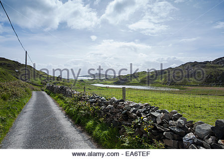 Walking trail on the Island of Inishbofin looking towards Connemara; Inishbofin Island, County Galway, Ireland - Stock Photo