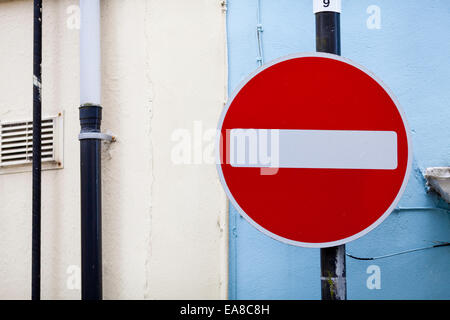 No entry sign against a blue wall, taken in Carmarthen, Carmarthenshire, South West Wales. - Stock Photo