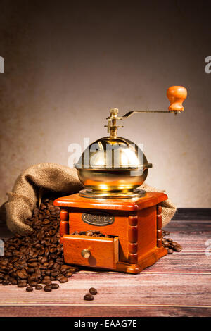 Coffee still life with wooden grinder - Stock Photo