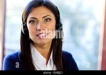 Female customer support operator with headset - Stock Photo