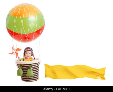 cheerful child girl on hot air balloon isolated on white - Stock Photo