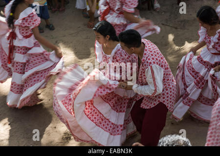 Para State, Brazil. A couple in traditional dress dancing Carimbo at a celebration in the poor rural settler community - Stock Photo