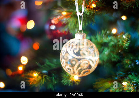 Christmas tree decorated with lights, balls, bells and other ornaments. - Stock Photo