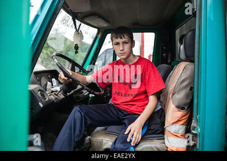 Mensur Ahmic, a 12 years old boy in fathers truck waiting for bullfight. Mensur`s father Nezir Zire Ahmic is the - Stock Photo