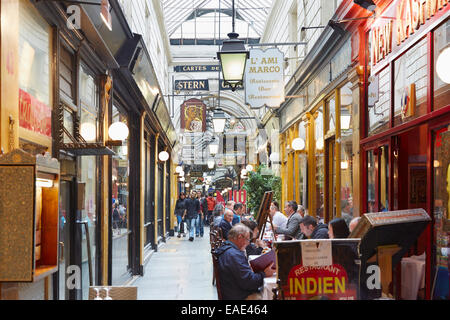 Paris, Passage des Panoramas with restaurants and people - Stock Photo