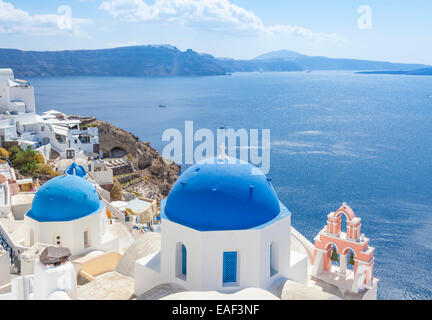 White greek church with blue dome & pink bell tower, Oia, Santorini, Thira, Cyclades Islands, Greek Islands, Greece, - Stock Photo