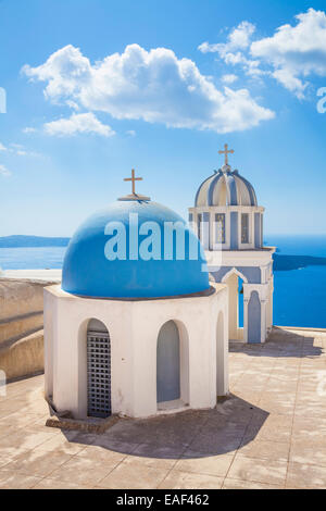 Bell Towers of Orthodox Church overlooking the Caldera in Fira Santorini Thira Cyclades Islands Aegean Sea Greece - Stock Photo