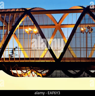 Cyclist passing by the Arganzuela bridge, designed by architect Dominique Perrault. Madrid Rio Park. Madrid. Spain - Stock Photo