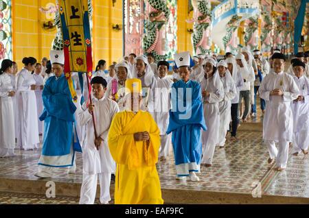 12 o'clock ritual ,Cao Dai temple ,Tay Ninh ,Vietnam - Stock Photo