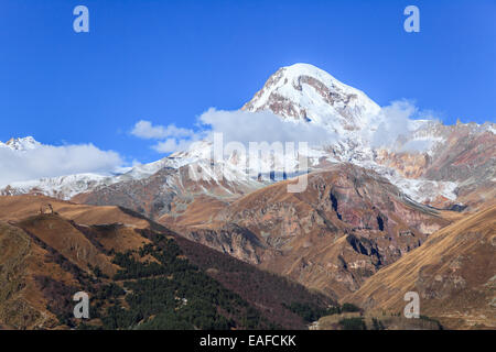 View of Mount Kazbek and Gergeti Monastery in Georgia - Stock Photo