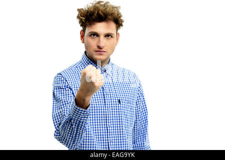 Serious angry man showing fist over white background - Stock Photo