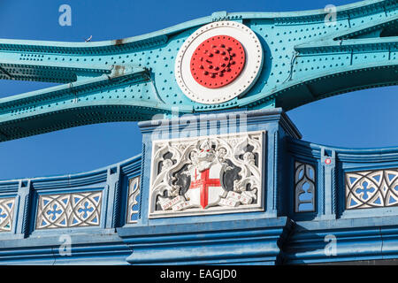 A colourful blue and red detail including crest at Tower Bridge, an iconic landmark in the City of London - Stock Photo