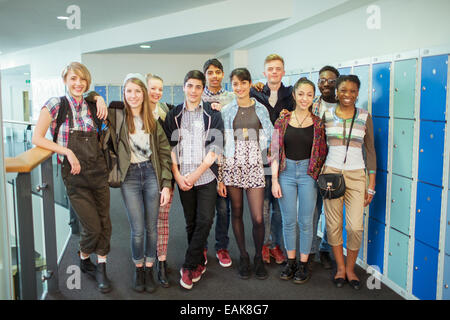 Group of students posing in corridor - Stock Photo