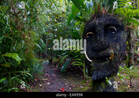 Wooden mask in a tribal village, Highlands, Papua New Guinea - Stock Photo