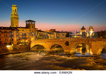 Ponte Pietra over River Adige with Cathedral Anastasia and the skyline of Verona beyond, Veneto, Italy - Stock Photo