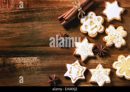 Christmas cookies with anise stars and cinnamon sticks over wooden background. Top view. - Stock Photo