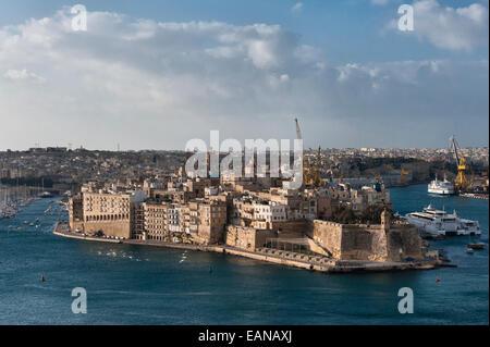 Senglea, Malta. Fort Saint Michael and the Grand Harbour seen from the Upper Barrakka Gardens in Valletta - Stock Photo