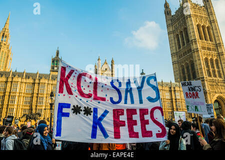 London, UK. 19th Nov, 2014. Students march through central London to demand that politicians scrap tuition fees. - Stock Photo