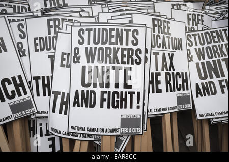London, London, UK. 19th Nov, 2014. Protest placards are stacked ready for thousands of students to march through - Stock Photo
