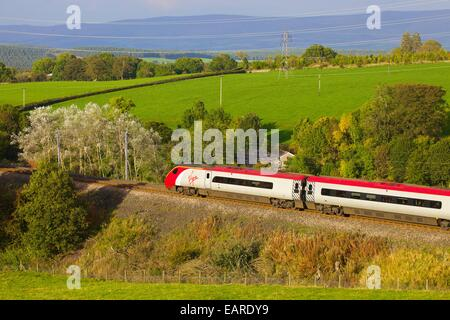 Class 390 Pendolino Virgin train passing Strickland Mill, Great Strickland, Cumbria, West Coast Main Line, England, - Stock Photo