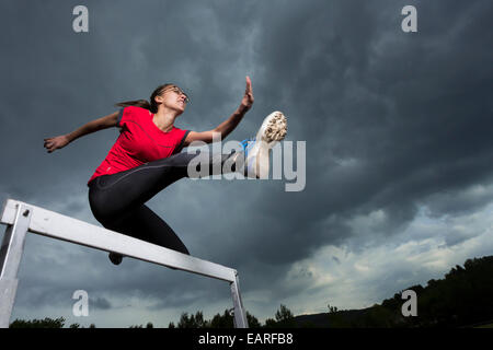 Athlete, 20 years, jumping hurdles, Winterbach, Baden-Württemberg, Germany - Stock Photo