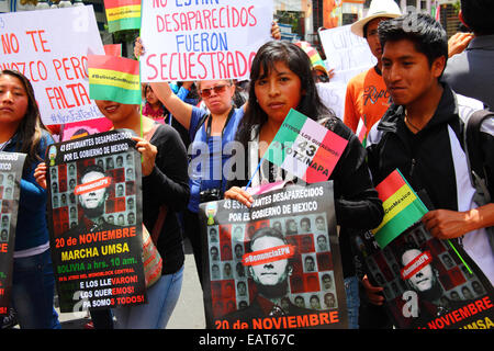 La Paz, Bolivia. 20th November, 2014. Protesters march to demand justice for the 43 missing students in Mexico and - Stock Photo