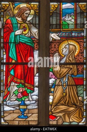 Trnava - The Heart of Jesus appearing to Saint Margaret Mary Alacoque on windowpane in St. Nicholas church - Stock Photo