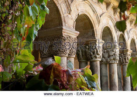 The arches of the cloister of  the monastery of Colegiata de Santa Juliana. - Stock Photo