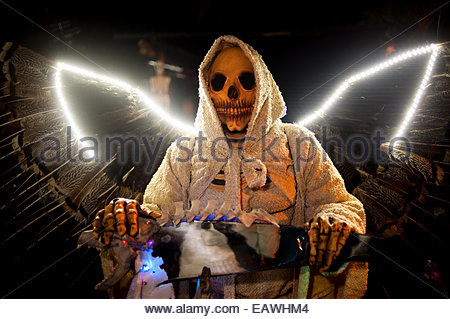 A celebrant dresses as The Grim Reaper for the Day of the Dead. - Stock Photo