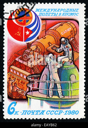 SOVIET UNION - CIRCA 1980: Stamp printed in The Soviet Union devoted to the international partnership between Soviet - Stock Photo