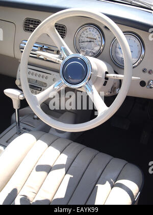 Nissan Figaro car interior, with leather seats and retro dashboard - Stock Photo