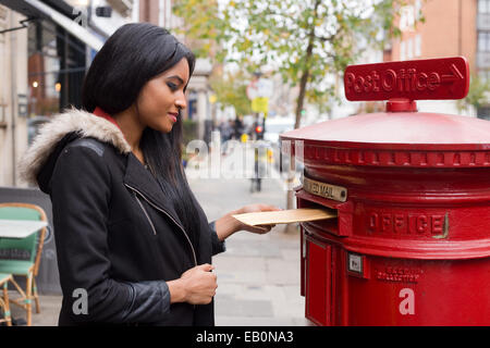 young woman posting letters. - Stock Photo