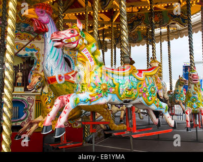 A waltzing horse on one of the fairground rides on Brighton Pier - Stock Photo