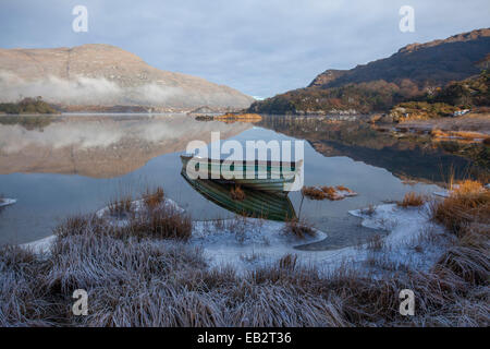 Frosty fishing boat on the shore of Upper Lake, Killarney National Park, County Kerry, Ireland. - Stock Photo