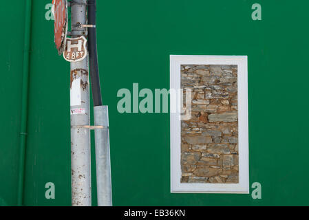 Stonewalled window in a green wall, Bo Kaap, Cape Town, South Africa - Stock Photo