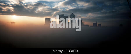 Cloud around Canary Wharf, London, England, UK - Stock Photo