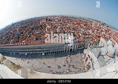 Fish eye lens view north west from St Marks Bell Tower Venice Italy showing Piazza San Marco with Clock Tower and - Stock Photo