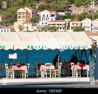 Vathy, Ithaca, Ionian Islands, Greece. Typical harbourside restaurant. - Stock Photo