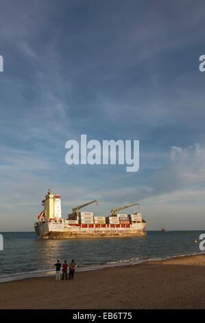 Container Ship Washed Up on Beach, El saler Beach, Valencia, Spain - Stock Photo