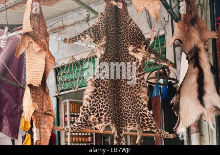 leopard pelt for sale in the ancient medina in Marrakech, Morocco - Stock Photo