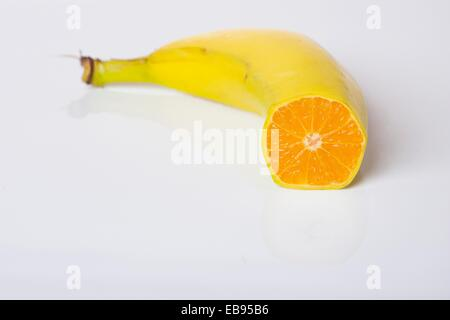 Digital Composite of Orange and Banana Fruit - Genetically Modified Food Concept - Stock Photo