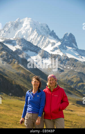 Aiguille Verte and Les Drus in the Mont blanc range above Chamonix, French Alps, with walkers doing the tour du - Stock Photo