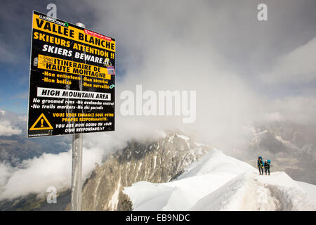 The Aiguille Du Midi above Chamonix, France, with climbers ascending the arete from the Vallee Blanche. - Stock Photo