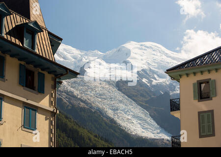 Mont Blanc and the Bossons glacier from Chamonix town, France. - Stock Photo