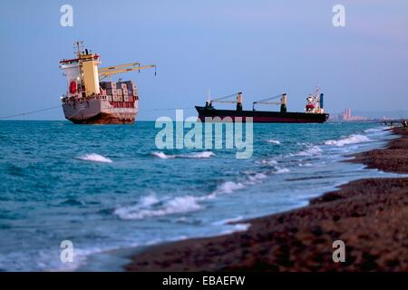 Container Ship Washed Up on Beach El saler Beach Valencia Spain - Stock Photo
